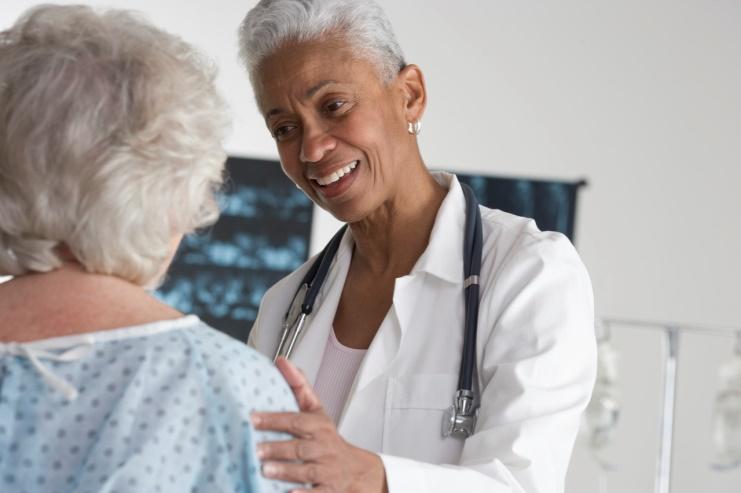 gp or nurse with patient